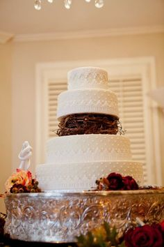 Four tier round wedding cake with twig detail | photography by http://doveweddingphotography.com/