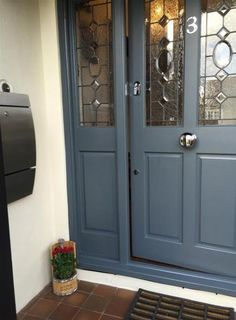 Indigo blue: 10 amazing ways to add this color to your home decorPaint your front door indigo blue! Color of the front door color. Decoration ideas for Grey Front Doors, Victorian Front Doors, Cottage Front Doors, Beautiful Front Doors, Porch Doors, Modern Front Door, Double Front Doors, Front Door Entrance, House Front Door