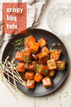 Crispy baked tofu bites are smothered in tangy sauce to make this absolutely scrumptious barbecue tofu! Vegan, optionally gluten-free, easy to make and deliciously addictive! #tofurecipes #bakedtofu #veganrecipes Easy Vegan Dinner, Vegan Dinner Recipes, Delicious Vegan Recipes, Vegan Dinners, Vegetarian Recipes, Tofu Meals, Teriyaki Tofu, Bbq Tofu, Tofu Recipes