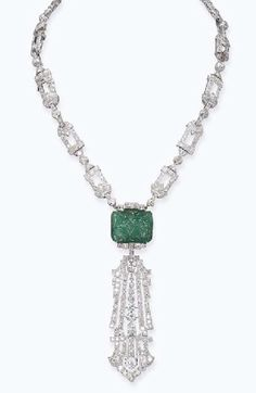 AN ART DECO EMERALD AND DIAMOND NECKLACE, BY RAYMOND C. YARD -  Designed as an open-work diamond necklace with diamond collet spacers, also forming a bracelet, suspending a rectangular-shaped carved emerald to the detachable diamond open-work pendant, circa 1925