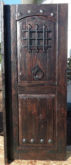 Rustic reclaimed lumber kiln dried entry door speakeasy 36  X 80  wrought iron & Rustic-reclaimed-lumber-kiln-dried-wood-stained-Arched-Door-Wine ...
