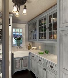 distressed gray with beadboard and hints of gray in countertops