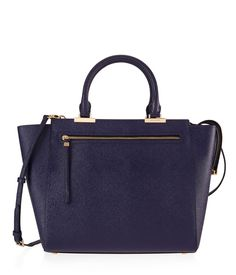 <p>The Gotham Patent Tote is this season's go-to handbag for fashionistas in the know. Crafted with lustrous patent leather and featuring ample interior space, a variety of pocket options, and Henri Bendel's signature details, this perfect pick-me-up will go everywhere with you - this season and next.</p>