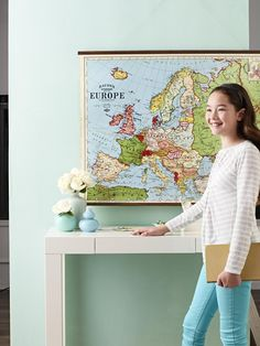 DIY: Vintage Map Poster from familycircle.com - Instructions on how to hang and mount a poster with wood trim. They also paste onto muslim