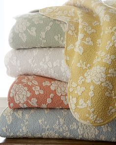 Intricately stitched floral sham has scalloped edges. Made of cotton. Backed with stripes. Machine wash. Imported.