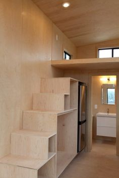 Black Pearl Tiny House by loft, storage tansu stairs /Nomad Tiny Homes 005