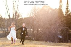 Wedding day portrait of couple running together while the sun is setting