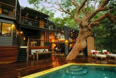 I love the porch built around the tree! I also really love he pool!
