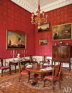 Easton Neston Revived. The Red Dining Room features a Regency pedestal table surrounded by circa-1860 chairs in the Queen Anne style.
