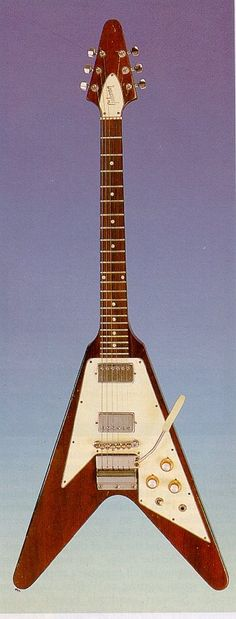 Gibson flying v:  I'm guessing 60's vintage. These guitars absolutely sang! I knew a guy who got a hold of one around '75 or so and had it repaired and restored. Amazing instrument!