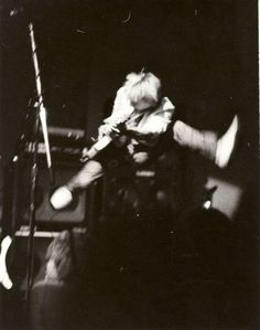 Mid-Air at Seattle's old Gorilla Gardens club circa '85.  Mike McCready defies gravity.
