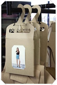 If you want to customize a good-looking t-shirt packaging, visit Papercut Patterns Packaging (hanger). If you want to customize a good-looking t-shirt packaging, visit Clothing Packaging, Fashion Packaging, Brand Packaging, T Shirt Packaging, Cardboard Packaging, Paper Packaging, Innovative Packaging, Sewing Room Organization, Design Poster