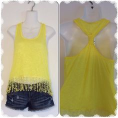 Yellow fringe racerback tank NWT, 100% Rayon, lightweight material, might need a cami underneath. Color is bright sunshine yellow (hard to capture in pictures but second picture is closest) . Please do not purchase this listing, please let me know what size you need and I will make a separate listing. Price firm unless bundled. I only have one of each size so don't wait!! Tops Tank Tops