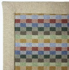 Uist Small Rug  A pure wool flat woven rug with a multi coloured checkerboard pattern with oatmeal binding. Woven in Scotland.