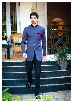 blue bandhgala with high neck and jodhpur trousers, pink hankerchief, sangeet o…