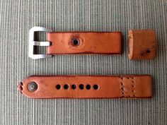 22mm leather watch strap - French ammo pouch, burnished edges, preserved stitching, holes from pocket loops, and brass rivet
