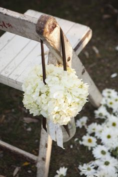 Hanging flowers & ceremony aisle lined with scattered daisies. (PS follow The LANE on instagram: the_lane)