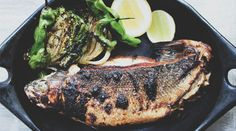 """We know what you're thinking: """"Why would I ever roast an entire fish at home? This whole-roasted branzino with shaved-fennel slaw is easy and the payoff is huge. Fish Recipes, Seafood Recipes, Cooking Recipes, Fish You Can Eat, Easy Weeknight Meals, Easy Meals, Roast Fish, Octopus, Kitchens"""