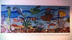 My students have worked on this mosaic piece for 4 years and it is now hanging on the wall by the main entrance of our school