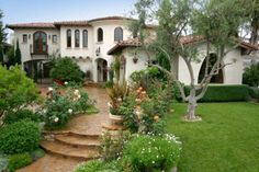 Spanish Colonial home - Curved Stairs with Stone Retaining Walls and White Stucco on House, Landscape Along Walk