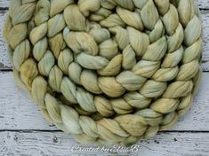 Pear - Hand dyed Organic Merino combed top. Good for spinning yarn, felting, blending