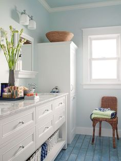 Storage Savvy; love the color of this bathroom - the blues and greens remind me of water.