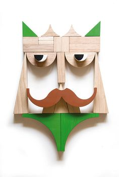 kids can make faces with this set of wooden building blocks
