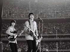 Handout photo issued by Omega Auctions of Paul McCartney (right) and George Harrison during The Beatles iconic Shea Stadium performance in August 1965 in New York