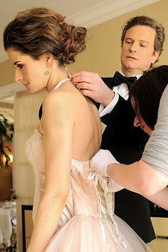"""Colin Firth assists wife Livia as she dresses for the 2011 Academy Awards. Colin has said, """"It does help to actually realize that however stunning the person is who is, you know, fluttering their eyelashes at you, she doesn't do anything to match up to your wife,"""" he said. """"Maybe it's shallow of me to have a wife that's so beautiful, but it makes things easier, to me she's the most beautiful woman in the world....You know, we've made it 15 years together. I think that's pretty good going, by…"""