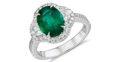 An extraordinary, one-of-a-kind ring showcasing a vibrant oval faceted emerald accented by two brilliant half moon diamonds set in exquisite 18k white gold and framed in a sparkling micropavé halo of round diamonds that extend around the band. The epitome of exquisite. This gorgeous ring is created by Blue Nile Jewelry