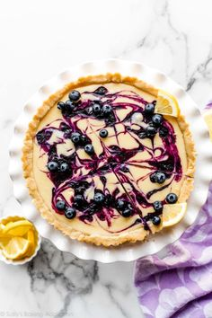 This creamy lemon tart sits in a buttery shortbread crust and is swirled with homemade blueberry sauce. Simple, yet impressive spring dessert recipe on sallysbakingaddiction.com Spring Desserts, Just Desserts, Delicious Desserts, Yummy Food, Blueberry Desserts, Blueberry Sauce, Blueberry Torte, Lemon Desserts, Pie Dessert