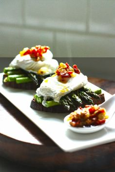 A simple breakfast- Roasted asparagus on toast with poached eggs and a warm…