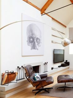 Giant skull artwork over a Eames Lounge chair