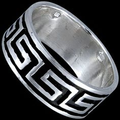 Silver ring, Greek design Silver ring, Ag 925/1000 - sterling silver. A classic Egyptian design stands out against the black background.