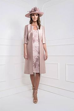 25921 Blush Crop (John Charles) A beautiful dress and frock coat, in a warm autumnal shade Blush. The dress is stunning with its pretty lace overlay with bold print and intricate clear sequin detailing throughout. The dress is a shift Read More...