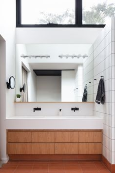 """Modscape recently refreshed classic mid-century home in Elsternwick with a modern yet respectful two-storey extension. """"The owners loved their mid-century Mid Century House, Timber Ceiling, Modern House, Ensuite Bathrooms, Modern, Exposed Brick Walls, Studio Apartment Design, Melbourne House, Bathroom Design"""