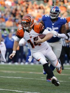 Cincinnati Bengals quarterback Andy Dalton scrambles in front of New York  Giants defensive tackle Johnathan Hankins during the first half of an NFL  ... 3488ae9f2