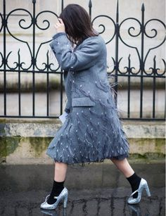 Make a statement in a feather-embellished coat + sparkly heels with socks