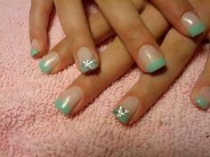 Gel nails mint tips with silver sparkles on ring fingers