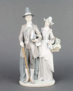 """Lot 100, A Lladro group of Quakers signed and dated 1993 5734 12"""" est £50-75"""