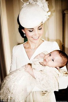 Kate shows her maternal side with her first daughter in her arms, right