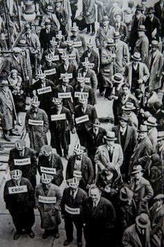 Anonymous.  A demonstration by unemployed workers (their various trades are on display) prepared to labor for $1 a week during the Great Depression, 1930s.