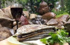 Jengyalov hats (the grain flat cake with greens) - rather widespread and used in meal in Artsakh during the whole year – generally, is not met in the cuisine of other regions of Armenia.  Jengyalov hats is a dish almost ceremonial, the basic meaning of its preparation is collecting together relatives and taking part in the overall activities, which are to get united once more, to talk about that and this, to exchange different news and simply to warm soul next to the loving hearts.