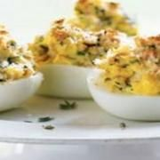Stuffed eggs are often served warm in France, and this recipe is similar to one from the Périgord region. If you plan to dye Easter eggs, cook extras for this dish. French Appetizers, Celebration Chocolate, Pizza Bake, Pizza Rolls, Egg And I, Deviled Eggs, Egg Recipes, Original Recipe, French Style