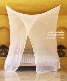 A shade of yellow that is like liquid sunshine, breezy delicate mosquito netting draped around the bed from the ceiling- creating a cozy haven to slumber! |Casa de Valentina -MOSQUITEIROS DELICADOS|