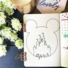 Bullet journal monthly cover page, April cover page, hand lettering, Disneyland outline drawing. | @lifemaderesplendent