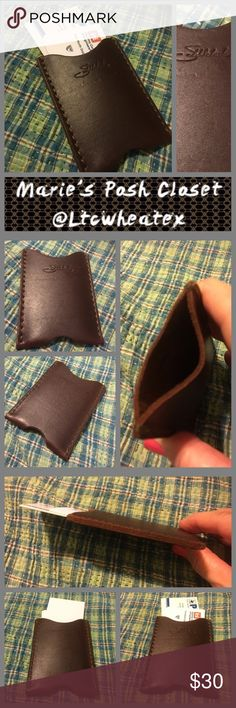 Saddleback Leather Business Card Holder Excellent condition for this leather holder, no scratches or marks of any kind, typical with dark leather products. This holds 10-12 standard sized and finished business cards. I used it but am now retired so no need for it, but high quality, stitched leather. Great price for Saddleback quality! Saddleback Bags Wallets