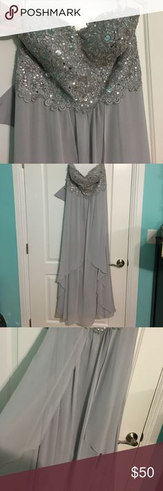 Bridesmaid gown Very lovely grey dress worn once. The bottom is a bit dirty and the dress has one or two small spots in the middle but nothing too crazy. Zipper followed by corset style back. Comes with Shaw. My mother wears size 12 and this fit her. Dresses