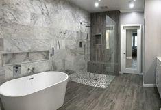 Walk-In Pebble Shower floor with a Marble back wall remodeled by 2 Diamonds Interior Design. #InteriorDesign #DecorativeHardware #HomeDecor #DIY #Remodel #mastershower #Architecture #showergoals #LuxuryHomes #Kitchen #HomeIdeas #HomeStyling #HomeRenovation #HomeDesign #HomeInspiration #DreamHome #ArchiLovers #BathroomDesign #BathroomRemodel #NewShower #ModernHome #NewConstruction