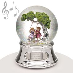 "Musical Water Globe  - Best Friends - This best friends water globe features two girls playing on a tree swing and it makes a perfect gift for any special person in your life. A musical water globe is a gift that is sure to be treasured. The music that plays is ""Music Box Dancer."" A great gift for your BFF especially when you engrave their name, date or other message."